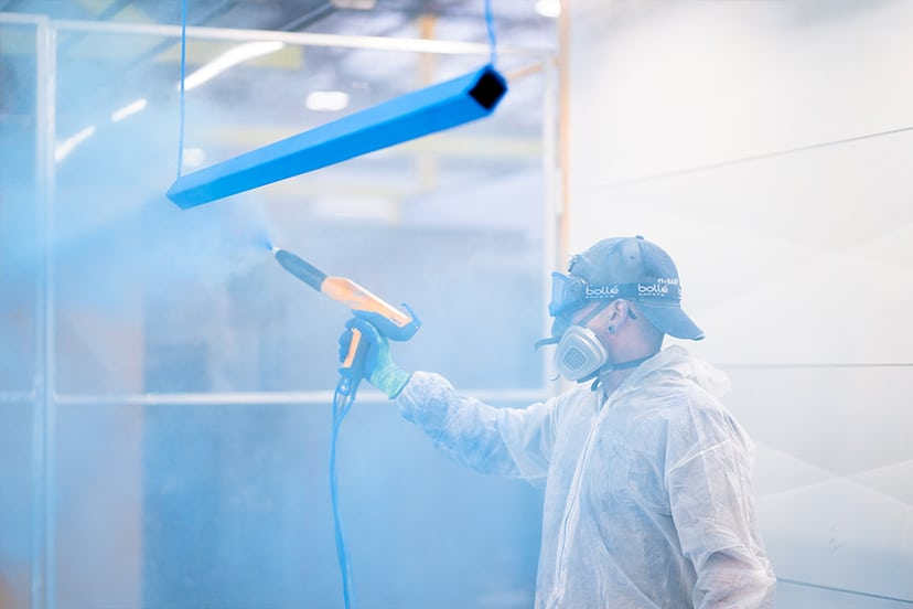 Man from a powdercoating perth company powdercoatng a piece of metal